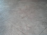Textured floor that has been coloured and cut for the tile look